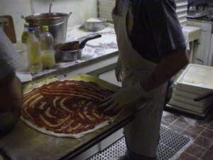 Making a pizza at Sally's Apizza!
