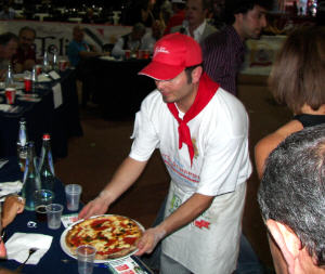 Tony Gemignani presents his award winning pizza to the Judges.