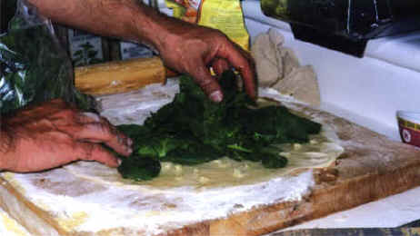 """Evenly spread spinach over dough..."""