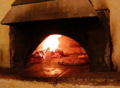 Joy Vogler's pizza on earth oven, in Charlotte, Vermont